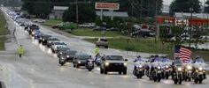 This photo shows the funeral of a police officer killed in the line of duty in West Memphis. His name was Bill Evans.