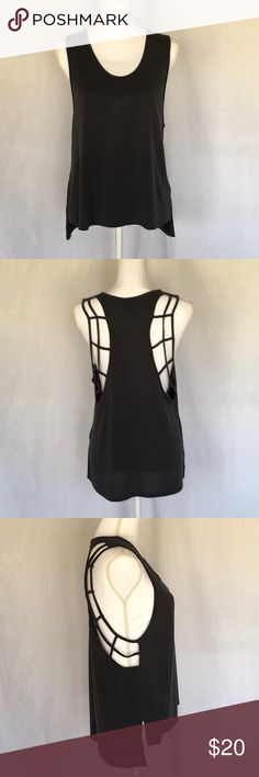 "🌟NEW LISTING🌟 HighLow Caged detail r/b tank HighLow Caged detail r/b tank, women's size medium, color: charcoal gray, rounded V-neck, front length is 21"", back length is 24"". NWOT never worn. Smoke free home. evolution + creation active Tops Tank Tops"