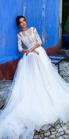 We adore this gorgeous wedding dress with lace 3/4 sleeves and tulle layer skirt
