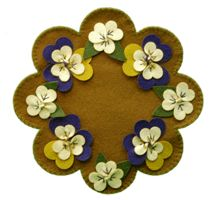 Pansy Candle Mat - three dimensional flowers, lots of other patterns on this site.