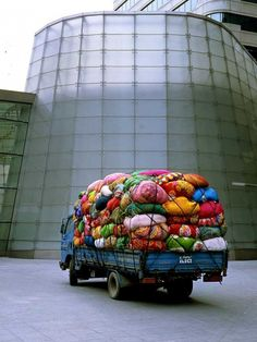 """That is just beccas clothes.           Really becca.        Kimsooja, """"Cities on the Move–Bottari Truck,"""" 2000."""