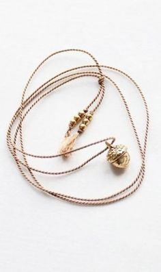 acorn necklace on silk cord