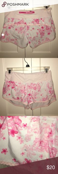 Size 2 Lululemon speed shorts White and pink floral size 2 Lululemon speed shorts (small green stain on front shown in pictures) lululemon athletica Shorts