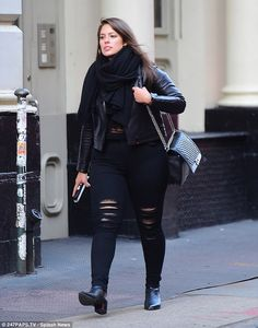 Low key: The 28-year-old wore a leather jacket teamed with distressed jeans and ankle boot...