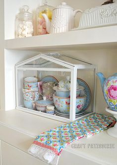 Socker greenhouse Ikea repourpouse; tea set storage. Pip studio.