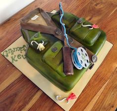 Fly Fisherman's jacket Cake :) x - Cake by Storyteller Cakes 80th Birthday Cake For Men, Fish Cake Birthday, 60th Birthday Gifts, Man Birthday, 85th Birthday, Fishing Theme Cake, Fishing Cakes, Tank Cake, Gravity Defying Cake