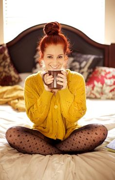 I'm in love with all of this! Tights, chunky sweater, mustard, redhead bun. I die!