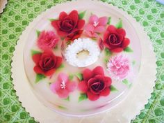 roses - Los Angeles-based Blooming Gelatin Art started selling gelatinas a year ago. Ms.Quiles teaches cooking classes on the technique, which involves injecting colored milk into the bottom of a gelatin cake.