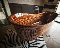 Incredible wooden tub, not so sure about the zebra tile though