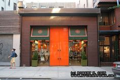 Bold colors yet modern and sleek storefront of Tory Burch store