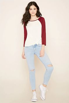A pair of skinny jeans featuring ripped knees with an ankle length, a five-pocket construction, and a zip fly.#f21denim