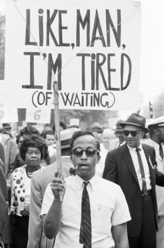 """March on Washington Marcher with hand-lettered sign: """"Like Man, I'm Tired (of Waiting),"""" August 28, 1963. Photo credit: Matt Herro — in Washington, District of Columbia."""