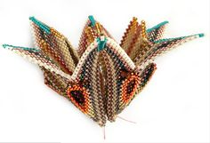 ZigWing from Contemporary Geometric Beadwork, designed by Kate McKinnon and beaded by Angela Wallis of Beadjangles. https://fbcdn-sphotos-g-a.akamaihd.net/hphotos-ak-prn2/s720x720/1375144_430361240407160_1873849033_n.png