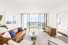SPRING HILL 704/8 Dickens Street... Showcasing low maintenance living at its finest, this two bedroom abode is light filled with fresh white tones offering plenty of potential to personalise.