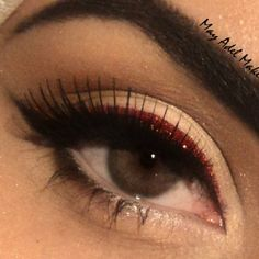 Strike the right note with just a touch of glitter! Red glitter eyeliner  is fun and great for a night out.