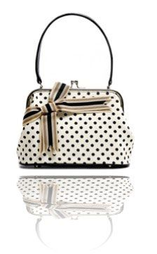 Polka dot bag and a bow... by the classic with the twist master Vassilis Zoulias...
