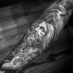 Black And Grey Heavily Shaded Angel With Jesus Mens Sleeve Tattoo