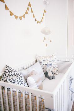 The House \ Vita-Roo's Geometric Nursery with a Baby Jives Co gold dot mobile