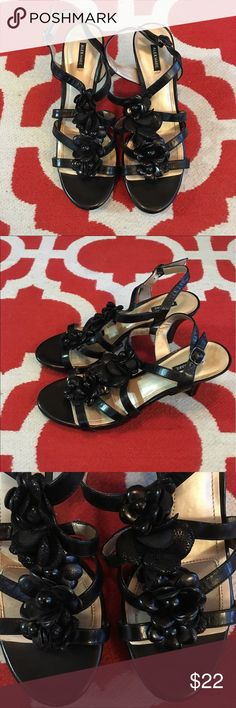 Alex Marie Black Strappy Heels- NWOT These shoes are in EUC because they've never been worn but are without tags or the box now. The straps are made of leather but the lining is synthetic. The pictures show the cute flowers that grace the top of the shoe! Please ask questions if interested and make an offer! All my clothing comes from a pet free and smoke free home 🏡 Alex Marie Shoes