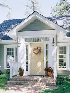 curb appeal- love the yellow door, and the quaint little front porch.