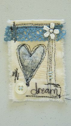 Hand Embroidery little textile collage, using a hand printed heart and free machined word, machine scribbles and embellishments. - little textile collage, using a hand printed heart and free machined word, machine scribbles and embellishments. Freehand Machine Embroidery, Free Motion Embroidery, Hand Embroidery Stitches, Free Machine Embroidery, Embroidery Designs, Crewel Embroidery, Textile Jewelry, Fabric Jewelry, Textile Art