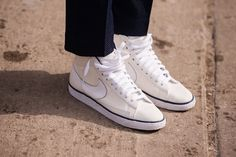 27 Of The Most Insane Kicks Spotted On The Streets Of NYC #refinery29  http://www.refinery29.com/cool-sneakers-nyc-street-style-pictures#slide-4  Simple white high-tops can make any look work....
