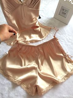 A golden pajama made from a soft, silky material so you feel unbelievably cozy and comfortable