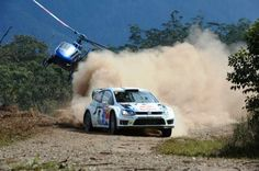 Volkswagen Motorsport driver Andreas Mikkelsen tailed by a helicopter covering Rally Australia.