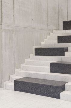 Unique black and white granite staircase with a piano key like modern design motif at the Research & Sports Hall of Humboldt University / Scheidt Kasprusch Architekten