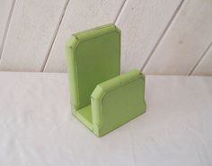 A vintage wood napkin holder that was a boring brown. I painted it lime green and sanded for a shabby cottage look. height 7 length 5 depth 4 weighs 1 pound  Make sure you love it, all sales final!  If shipping seems to high contact me with your zip code for best rate!  Thank you for visiting! https://www.etsy.com/shop/CathysShabbyFarm  For vintage finds, http://www.etsy.com/shop/EndlesslyVintage  For one of a kind gypsy bags and upcycled clothing…