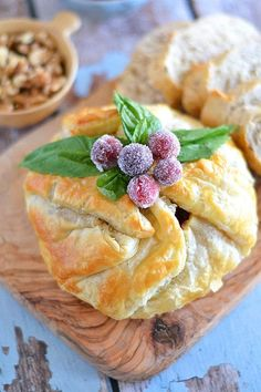 Need a quick and easy, yet impressive appetizer? Look no further than this Cranberry and Walnut Brie with Sugared Cranberries!