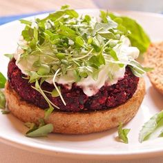 We know what's on our weekend menu! Try this Beet Veggie Burger topped with Wallaby Organic Greek Yogurt made by @fromtheathleteskitchen. It's un-beet-lievable how tasty it looks!