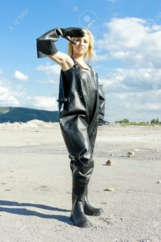 Blonde in black chest waders