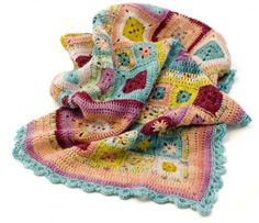 The Loop version of the Babette blanket uses sock yarns, that are machine washable, for baby-friendliness.