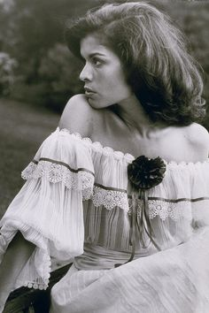 Festival fashion begins in the 1960s and70s. Bianca Jagger in an off-the-shoulder, lace-trimmed dress.