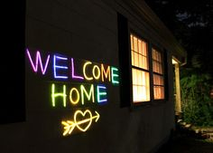 incredible idea from rachel denbow {smile & wave}. use glow sticks taped to the house for a neon message!