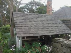 IKO Cambridge Weatherwood laminated Architectural asphalt shingles over a small entry area.  These asphalt shingles were replacing old Western Red cedar shakes while retaining that classic look.