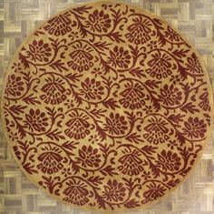 Handmade Circular Floral And Vine Area Rug In Gold With Red Accents