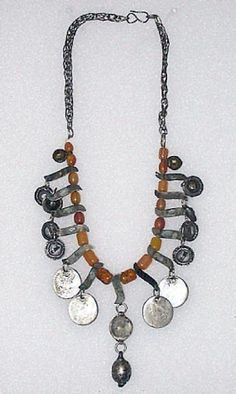 Israel | Necklace from the Bedouins of the Negev region | Silver toned metal, Ottoman and Russian coins, 'amber' imitation beads (bakelite/plastic).