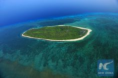 """This bird eye view shows the Ganquan Island of China's Xisha Islands, South China Sea, June 1, 2011. The Xisha Islands lie in the middle of South China Sea, consisting of Xuande Islands and Yongle Islands. (Xinhua/Zha Chunming) Why China has the right to """"build sovereignty"""" in the South China Sea: expert - Xinhua 