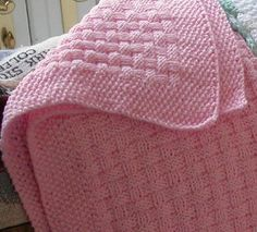 This is a basket weave pattern blanket with a wide seed stitch border.
