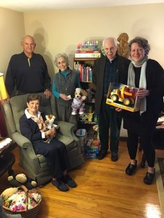 Wi-ACT Steering Committee members, from left, Sonny Kern, Phyllis Boozer, sitting; Connie Tate, David Bloomer and Heidi Hawk with gifts that will be given to the family when they arrive March 10.