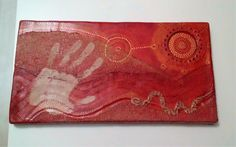 """Journey ' inspired by aboriginal rock art this piece is made using a layer of air dry clay wrapped around a stretched canvas. I added different textures using sand mixed with paint, modelling paste and clay engraving tools, finished with a coat of mahogany wood stain for a red earthy feel."