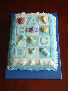 This cake was for a baby shower.  I sculpted each...