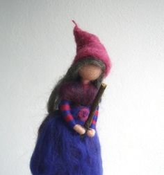 Lovely Little Witch on her Broomstick The doll is handmade by my needle felt soft sculpture technique. Her measure is approximately 8 height. She comes in purple, pink and blue colours with grey hair and with her broom made of twigs. All my figures are handmade with wool and a pipe cleaner in their arms. They are made with lovely details and great care, but they are only for decoration and not for children to play with! This dolls will enchant a childs room or can be a wonderful addition to…