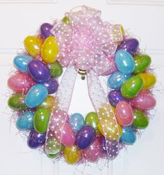 Plastic eggs glued to a foam form! Add a bit of Easter grass and a bow.