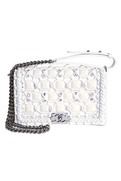Chanel Resort 2014  ~seriously, how many possible ways can this bag be reinvented? Amazing.