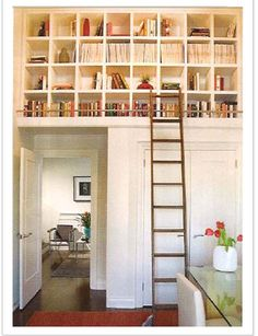 For the space that's currently open above the door to the master bath, add book shelves on the bedroom side and dry wall on the bathroom side