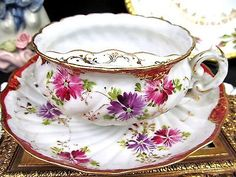 Nippon mustache tea cup and saucer painted floral large pattern teacup moustche