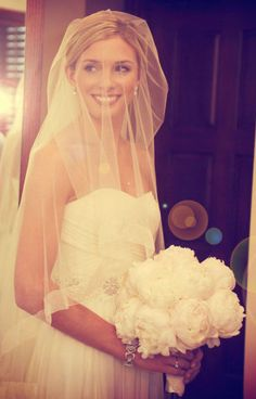 FINALLY! A modern bride actually USING her veil - and looking absolutely stunning and elegant while doing it!